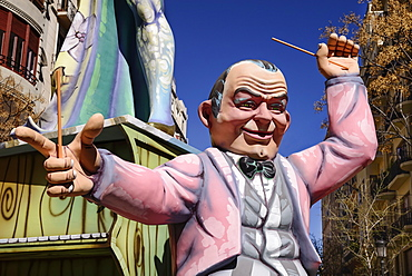 Spain, Valencia Province, Valencia, Papier Mache figure of a man in a pink jacket in the street during Las Fallas festival.