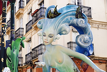 Spain, Valencia Province, Valencia, Papier Mache figure of mermaid in the street during Las Fallas festival.