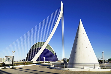 Spain, Valencia Province, Valencia, La Ciudad de las Artes y las Ciencias, City of Arts and Sciences,El Pont de l'Assut de l'Or Bridge and Agora with lift from Umbracle car park in foreground.,