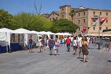Spain, Catalonia, Barcelona, Tourist stalls nect to Museu D'Historia De Catalunya.
