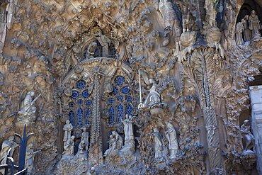 Spain, Catalonia, Barcelona, Eixample, exterior of La Sagrada Familia, designed by Antoni Gaudi.