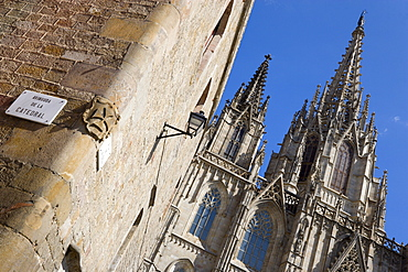Spain, Catalonia, Barcelona, The spire and main facade of the Cathedral in the Old Town district.