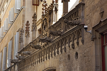 Spain, Catalonia, Barcelona, Gargoyles on a building in the Gothic District.