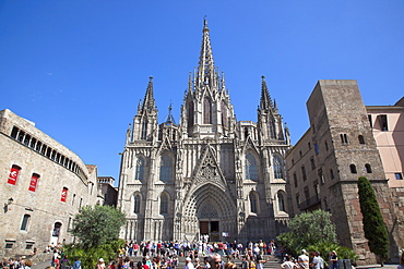 Spain, Catalonia, Barcelona, Tourists outside the Cathedral of the Holy Cross and Saint Eulalia.,