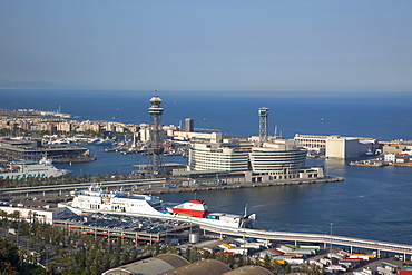 Spain, Catalonia, Barcelona, View over the commercial port from the hilltop Parc du Montjuic.