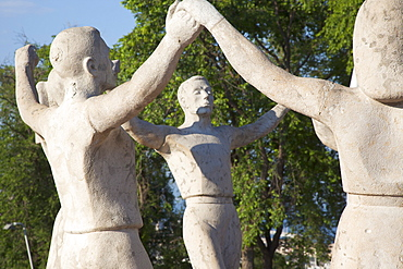 Spain, Catalonia, Barcelona, Monumento a la Sardana stone sculpture in Parc de Montjuic depicting the Catalan national dance.