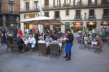 Spain, Catalonia, Barcelona, Cafe with tourists sat outside in La Ribera.