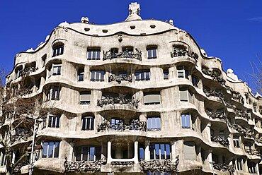 Spain, Catalunya, Barcelona, La Pedrera by Antoni Gaudi, a section of the building's facade.