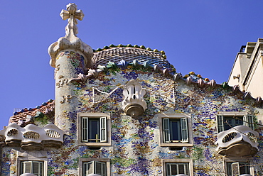 Spain, Catalunya, Barcelona, Casa Batllo by Antoni Gaudi, upper section of the exterior facade.