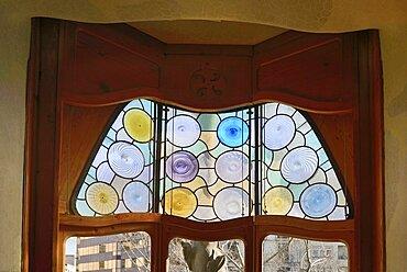 Spain, Catalunya, Barcelona, Casa Batllo by Antoni Gaudi, detail of window in the interior.