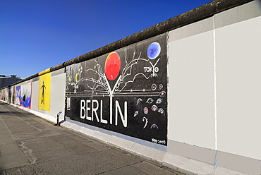 Germany, Berlin, The East Side Gallery, a 1.3 km long section of the Berlin Wall, mural with the word Berlin prominently displayed.