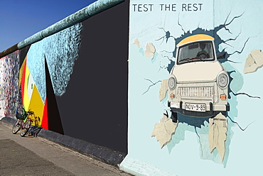 Germany, Berlin, The East Side Gallery, a 1.3 km long section of the Berlin Wall, Birgit Kinder's mural known as 'Test the Best' .