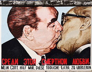 Germany, Berlin, The East Side Gallery, a 1.3 km long section of the Berlin Wall, Mural called My God help me survive this deadly love, Soviet Premier Brezhnev kisses East German Chancellor Honecker.
