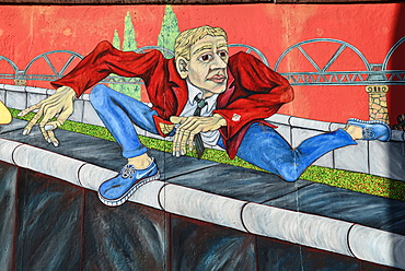 Germany, Berlin, The East Side Gallery, a 1.3 km long section of the Berlin Wall, 'The Wall Jumper' by Gabriel Heimler.