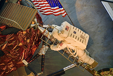 USA, Washington DC, National Mall, National Air and Space Museum, Lunar module with astronaut figure climbing the steps.