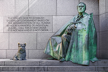 USA, Washington DC, National Mall, President Franklin Delano Roosevelt Memorial, Statue of the former President seatedl with his dog Fala.