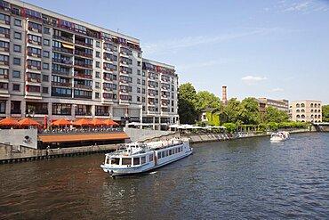 Germany, Berlin, Mitte, Tourist Cruise boats on the River Spree near Friedrichstrasse.