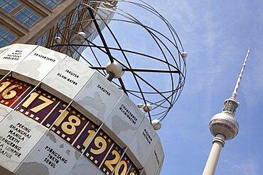 Germany, Berlin, Mitte, Alexanderplatz, the World Clock with Fernsehturm TV Tower behind.