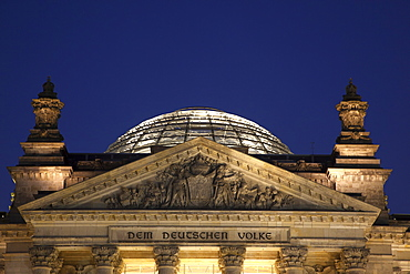 Germany, Berlin, Mitte, Reichstag building with glass dome deisgned by Norman Foster, illuminated at night.