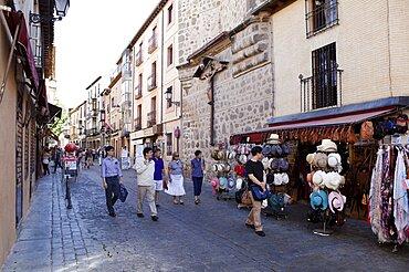 Spain, Castilla La Mancha, Toldeo, Calle Santo Tome with tourists and souvenir shops.