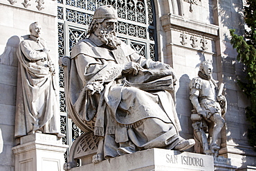 Spain, Madrid, Statues of San Isidoro outside the National Library.