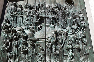 Spain, Madrid, Detail of the carving on the main door to the Cathedral de la Almudena featuring Pope John Paul II.