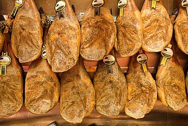 Spain, Madrid, Display of jamon.