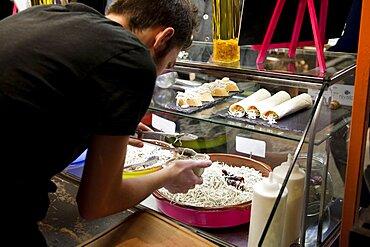 Spain, Madrid, Mercado de San Miguel, serving up elvers.