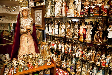 Spain, Madrid, Interior of shop selling religious statues and paraphernalia.