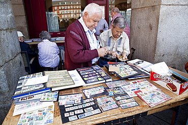 Spain, Madrid, Stamp collectors in the Plaza Mayor.