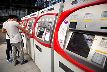 Spain, Madrid, Self-service ticket machines at Principe Pio metro station.