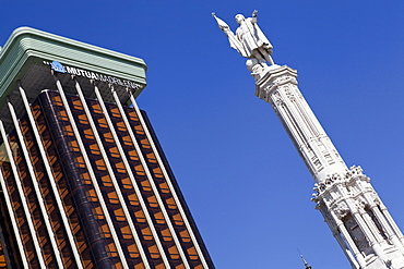 Spain, Madrid, Statue of Christopher Columbus and the Colon Towers at Plaza de Colon.