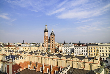 Poland, Krakow, Rynek Glowny or Main Market Square, View from the Town Hall Tower Observation deck over the Sukiennice or Cloth Hall to St Marys Church.