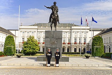 Poland, Warsaw, Poland, Warsaw, Ul Krakowskie Przedmiescie or The Royal Way, Radziwill Palace, Presidential Residence with a statue of Prince Józef Poniatowski and 2 guards in front.