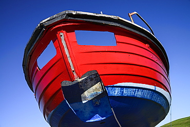 Ireland, County Sligo, Rosses Point, Colourful boat on the shore.
