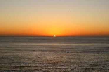 Malta, Sliema, Mediterranean sunrise and small fishing boat.