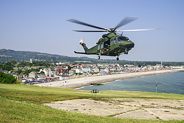Ireland, County Wicklow, Bray, Irish Air Force helicopter display above Bray seafront.