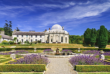 Ireland, County Wicklow, Bray, Kilruddery House and Gardens, View from the west side featuring the domed Orangery building with formal gardens in the foreground.