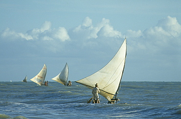 BRAZIL Ceara Near Fortaleza Jangdas boats going fishing in the early morning choppy seas