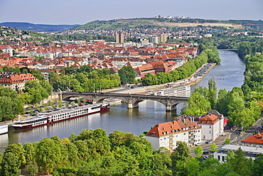 Germany, Bavaria, Wurzburg, View eastwards from Festung Marienburg fortress over the River Main with cruise boats.