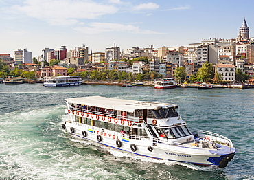 Turkey, Istanbul, Passenger ferry in the Golden Horn, and Galata Tower.