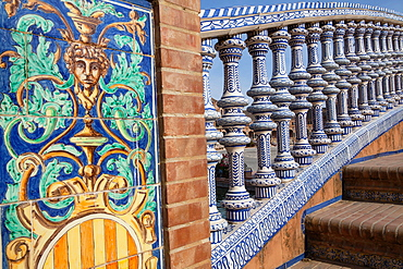 Spain, Andalucia, Seville, Detail of the ceramic balustrade on a bridge over the moat at the Plaza de Espana.