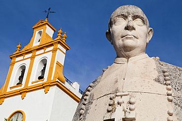 Spain, Andalucia, Cordoba, Statue of Fray Albino González Menéndez-Reigada Bishop of Cordoba from 1946 to 1958  in front of iglesia de San Jose.