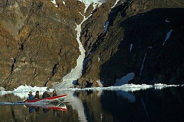 CANADA Nunavut Baffin Island Four Inuit men is boat for a fishing trip Eskimo