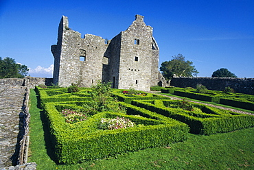 NORTHERN IRELAND Fermanagh Tully Tully Castle. Ruins of a fortified plantation house dating from 1610 with recently planted early 17th century style formal garden