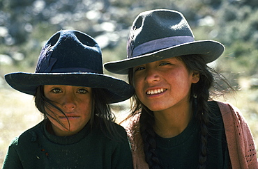 PERU Ancash Cordillera Blanca Head and shoulders portrait of two girls from Quebrada Quilcayhuanca.