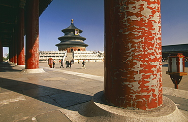 CHINA  Beijing Temple of Heaven.  Hall of Prayer for Good Harvests through colonnade of pillars with peeling red paint.   Peking