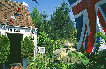 UNITED KINGDOM Channel Islands Guernsey Forest Parish. German Occupation Museum. Main entrance with Union Jack flag flying in forground.