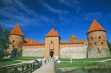 LITHUANIA  Trakai Visitors on bridge to entrance of Trakai Castle.