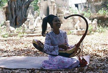 MYANMAR  Amarapura Female musician playing Burmese harp.  Burma